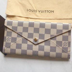 Authentic Louis Vuitton leather clutch wallet